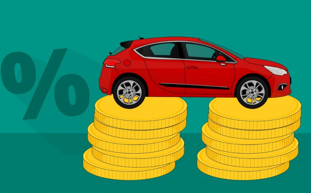 image of a car on top of money